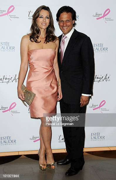 Elizabeth Hurley and Arun Nayar attend the Evelyne H Lauder photo Exhibition at Galeries Lafayette on June 1 2010 in Paris France
