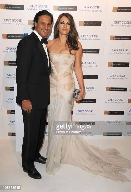 Elizabeth Hurley and Arun Nayar attend the 'Grey Goose Character & Cocktails:The Elton John Aids Foundation Winter Ball' at Grey Goose Maison de Mode...