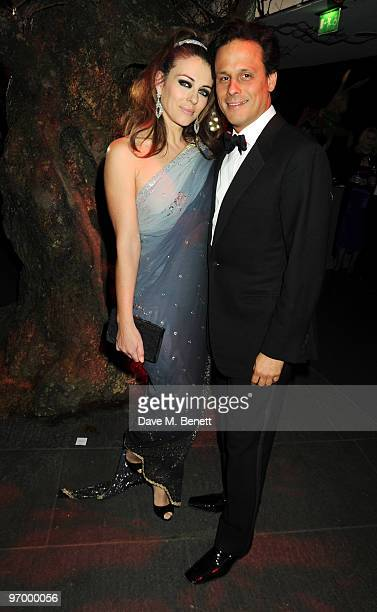 Elizabeth Hurley and Arun Nayar attend the Love Ball London at the Roundhouse on February 23 2010 in London England