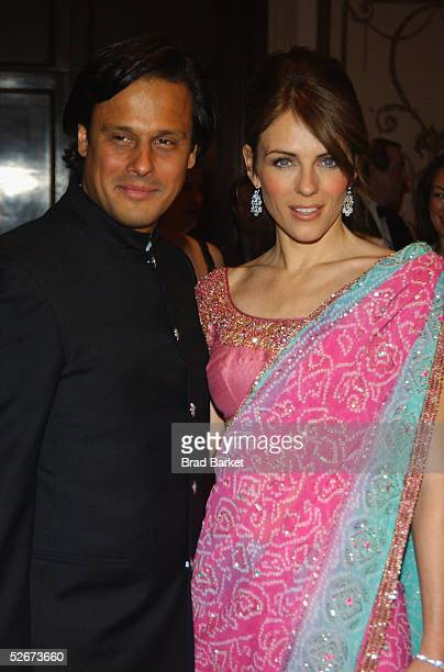 Elizabeth Hurley and Arun Nayer arrive at the Breast Cancer Research Foundation's Annual Hot Pink Party at the WaldorfAstoria on April 20 2005 in New...