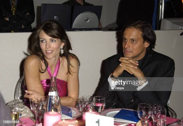Elizabeth Hurley and Arun Nayer during 2003 Cannes Film Festival Cinema Against AIDS 2003 to benefit amfAR sponsored by Miramax Dinner at Le Moulin...