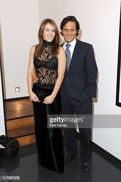 Elizabeth Hurley and Arun Nayer during Marc Hom and Tim Jefferies Host Party to Celebrate the Launch of Marc Hom's Book Portraits at Hamiltons...