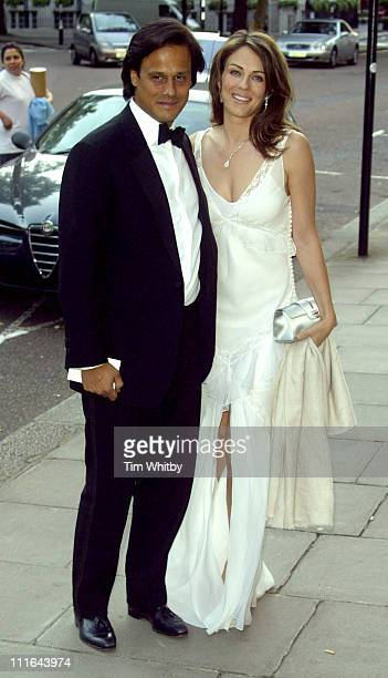 Elizabeth Hurley and Arun Nayer during Salvatore Ferragamo Dinner Fashion Show Arrivals at Italian Embassy in London Great Britain