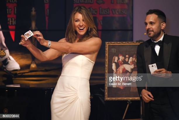 Elizabeth Hurley and Dynamo attend the Woodside Gallery Dinner in benefit of Elton John AIDS Foundation in partnership with BVLGARI at Woodside on...