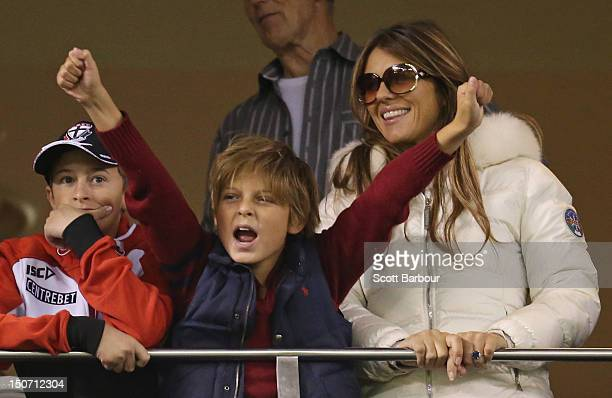 Elizabeth Hurley and her son Damian Hurley watch as Shane Warne plays a game of Aussie Rules football as he takes part in the St Kilda Thank You...