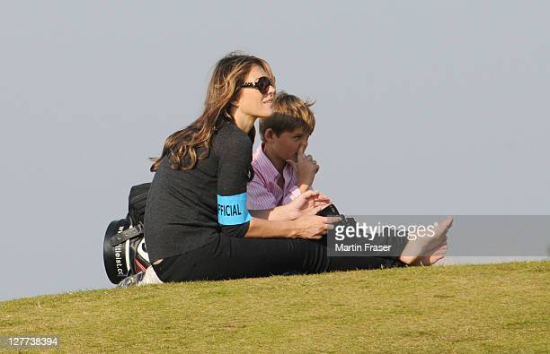Elizabeth Hurley and her son Damian watch Shane Warne on day two of Alfred Dunhill Links Championship on September 30 2010 in St Andrews Scotland