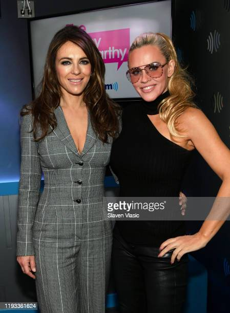 Elizabeth Hurley and Jenny McCarthy pose for photos at The Jenny McCarthy Show at SiriusXM Studios on December 11, 2019 in New York City.