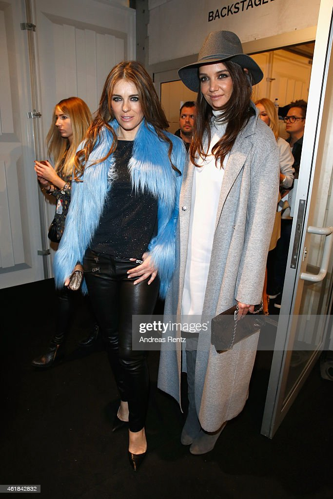 Elizabeth Hurley (L) and Katie Holmes attend the Marc Cain show during the Mercedes-Benz Fashion Week Berlin Autumn/Winter 2015/16 at Brandenburg Gate on January 20, 2015 in Berlin, Germany.