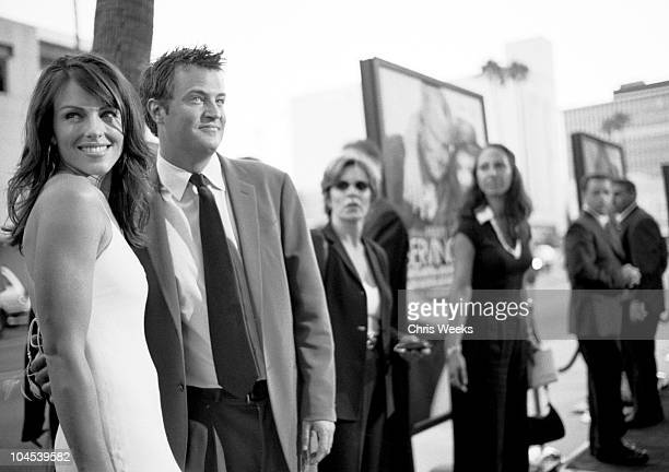 Elizabeth Hurley and Matthew Perry during 'Serving Sara' Premiere Arrivals Black and White Photography by Chris Weeks at Academy Theatre in Beverly...