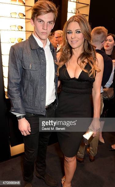 Elizabeth Hurley and Miles Hurley attend the DSQUARED2 celebration of London Flagship Opening on April 21 2015 in London England