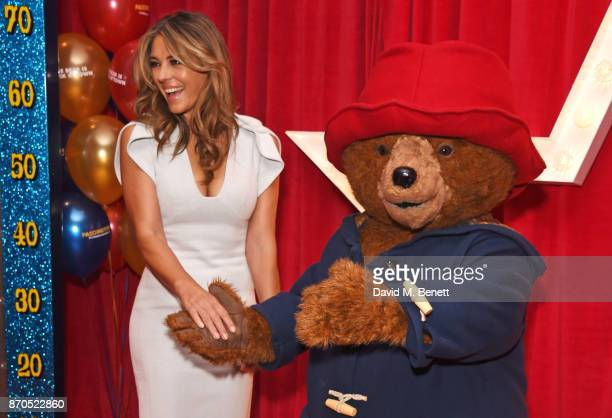Elizabeth Hurley and Paddington Bear attend the World Premiere of 'Paddington 2' at Odeon Leicester Square on November 5 2017 in London England