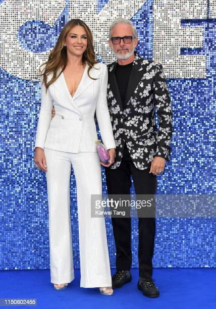 Elizabeth Hurley and Patrick Cox attend the Rocketman UK premiere at Odeon Luxe Leicester Square on May 20 2019 in London England