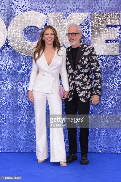 Elizabeth Hurley and Patrick Cox attend the Rocketman UK Premiere at Odeon Leicester Square on May 20 2019 in London United Kingdom
