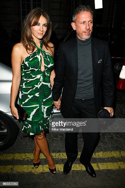 Elizabeth Hurley and Patrick Cox attend UK Film Premiere of 'A Single Man' at The Curzon Mayfair on February 1 2010 in London England