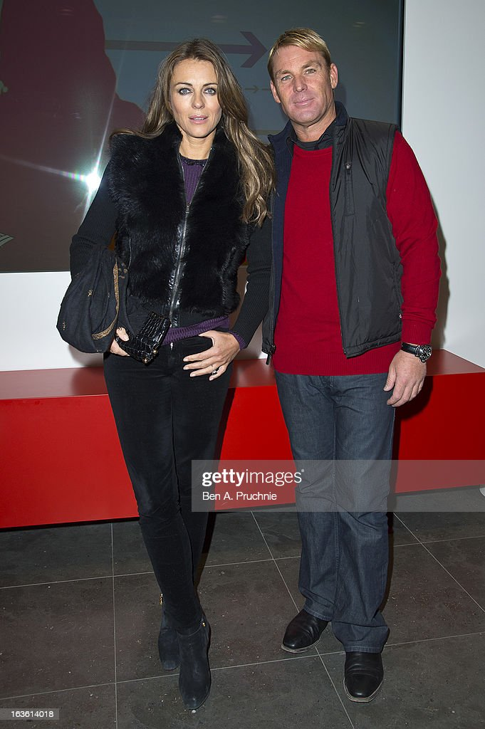 Elizabeth Hurley and Shane Warne attend the screening of Tania Bryer's CNBC interview with former President Bill Clinton on March 13, 2013 in London, England.