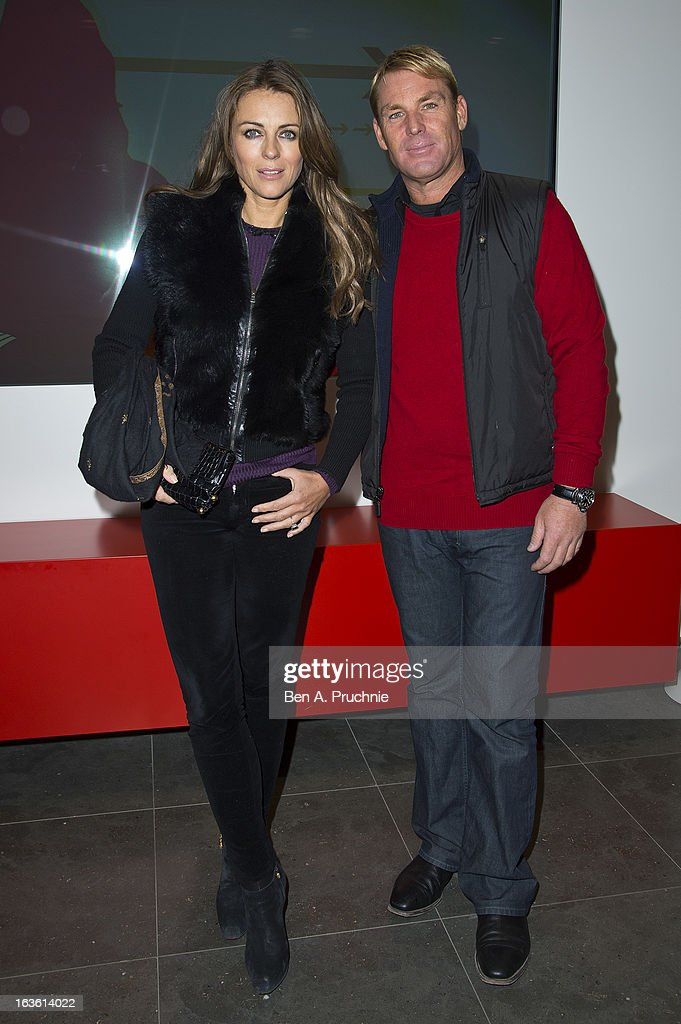 Elizabeth Hurley and Shane Warne attends the screening of Tania Bryer's CNBC interview with former President Bill Clinton on March 13, 2013 in London, England.