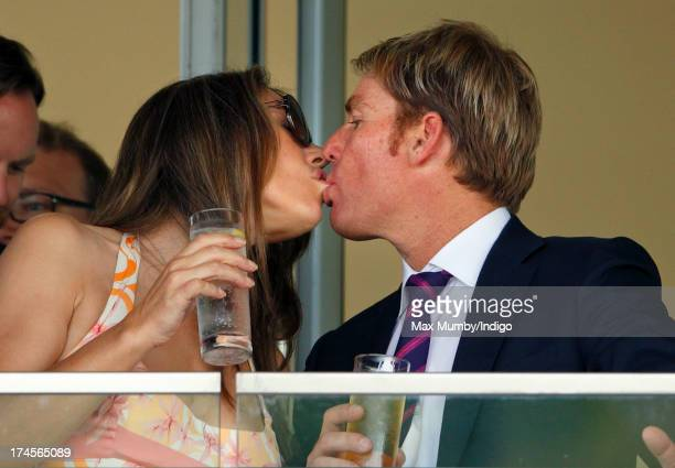 Elizabeth Hurley and Shane Warne kiss whilst watching the racing as they attend the Betfair Weekend, featuring the King George VI and Queen Elizabeth...
