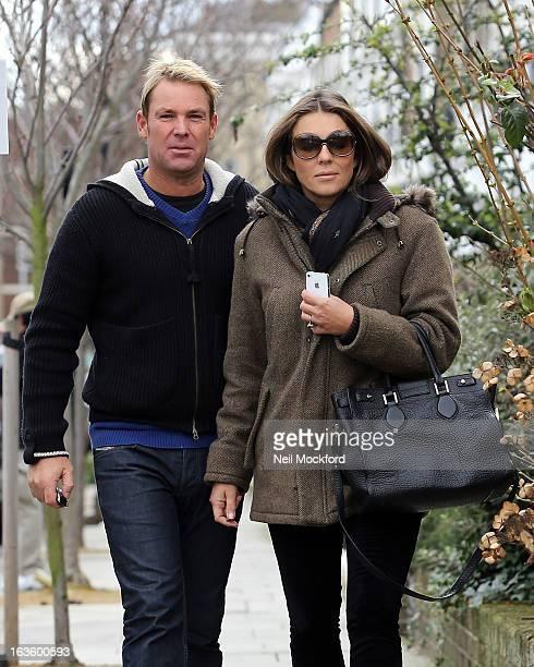 Elizabeth Hurley and Shane Warne seen walking near their Fulham home on March 13 2013 in London England