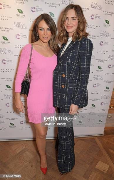 Elizabeth Hurley and Trinny Woodall attend Turn The Tables 2020 hosted by Tania Bryer and James Landale in aid of Cancer Research UK at Fortnum &...