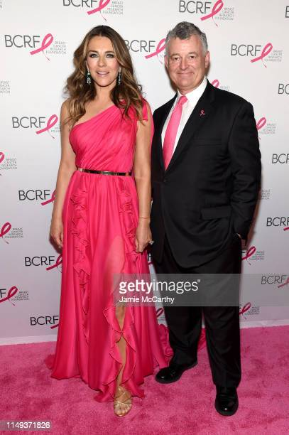 Elizabeth Hurley and William P Lauder attend the Hot Pink Party hosted by the Breast Cancer Research Foundation at Park Avenue Armory on May 15 2019...