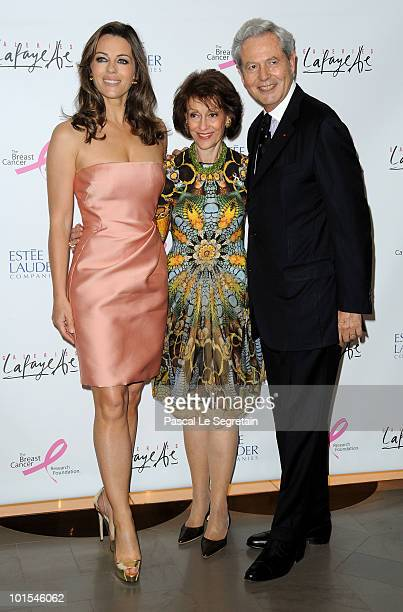 Elizabeth Hurley, Evelyn Lauder and Philippe Houze attend the Evelyne H.Lauder photo Exhibition at Galeries Lafayette on June 1, 2010 in Paris,...