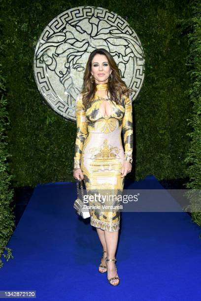 Elizabeth Hurley is seen on the front row of the Versace special event during the Milan Fashion Week - Spring / Summer 2022 on September 26, 2021 in...