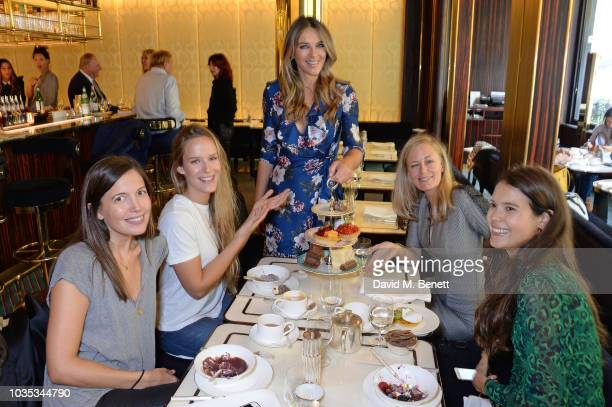 Elizabeth Hurley poses with Amanda Sheppard Hum Fleming Astrid Harbord and Sarah Ann Macklin attend the World's Biggest Coffee Morning hosted by...