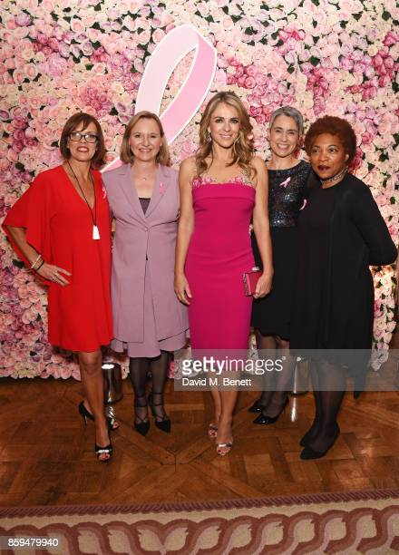 Elizabeth Hurley poses with Breast Cancer survivors Sally Broom Natalie Coombs Paula Beetlestone and Annette Jackson attend the 25th Anniversary of...