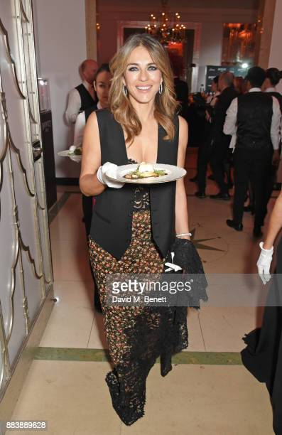 Elizabeth Hurley serves dinner at the BOVET 1822 Brilliant is Beautiful Gala benefitting Artists for Peace and Justice's Global Education Fund for...