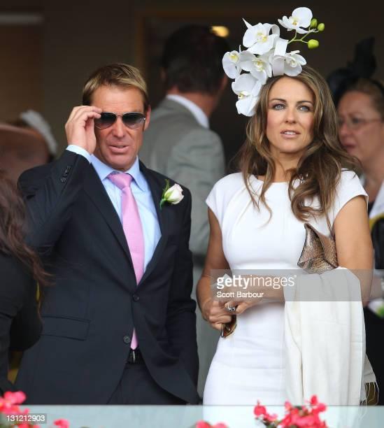 Elizabeth Hurley & Shane Warne attend Crown Oaks Day at Flemington Racecourse on November 3, 2011 in Melbourne, Australia.