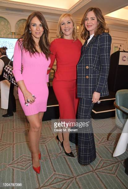 Elizabeth Hurley, Tania Bryer and Trinny Woodall attend Turn The Tables 2020 hosted by Tania Bryer and James Landale in aid of Cancer Research UK at...