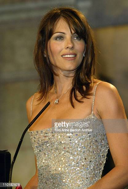 Elizabeth Hurley wearing jewelry by Chopard during 2003 Cannes Film Festival Closing Ceremony Show at Palais des Festivals in Cannes France