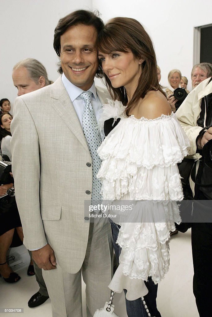 Elizabeth Hurley with Arun Nayar attend the Chanel Spring/Summer 2005 Fashion Show during Paris Fashion Week on July 7, 2004 in Paris, France.