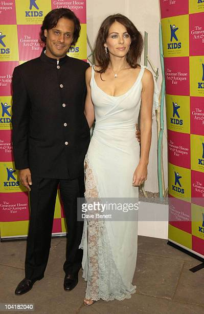 Elizabeth Hurley With Boyfriend Arun Nayar The Kids Charity Gala Evening At The Grosvenor House Arts And Antiques Fair Grosvenor House Hotel London