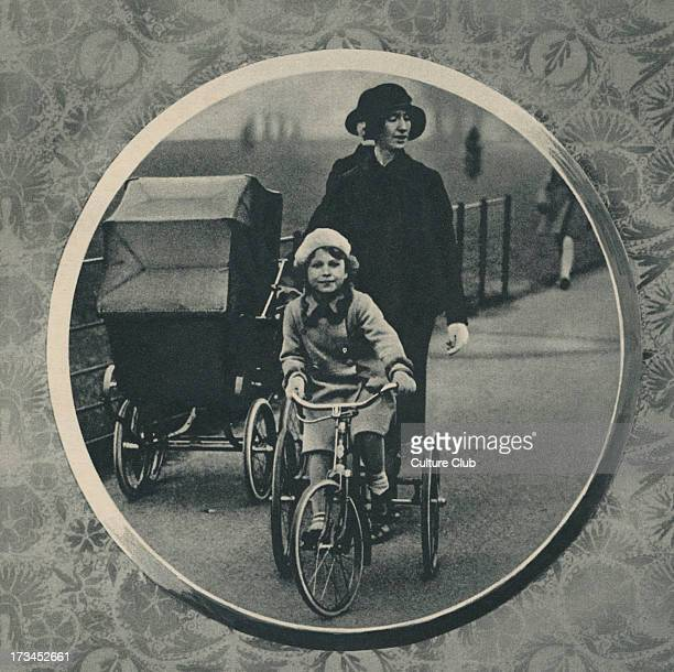 Elizabeth II and Queen Margaret as children with a nanny Caption reads 'Princess Elizabeth riding her new tricycle in the park with her sister in the...