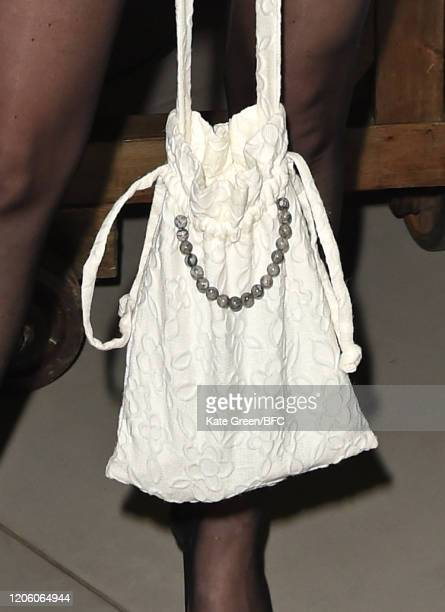 Elizabeth Jane Bishop bag detail attends the Wolf Badger 10th Year Anniversary party during London Fashion Week February 2020 at Coal Drops Yard on...