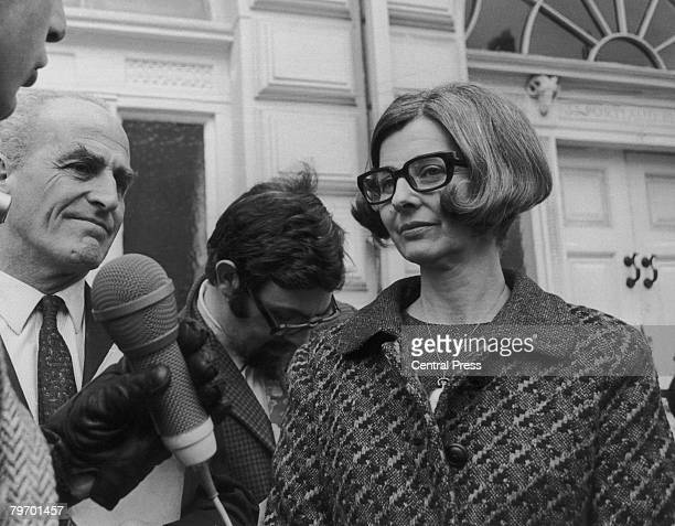 Elizabeth Johnson outside the office of the Chinese Charge d'Affaires in London with her MP, Michael Winstanley , 9th April 1970. The pair are...