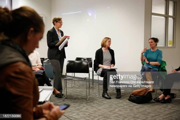 Elizabeth Kristen , Legal Aid At Work director gender equality and LGBT rights program; Kim Turner, Legal Aid At Work attorney listen as Allison...