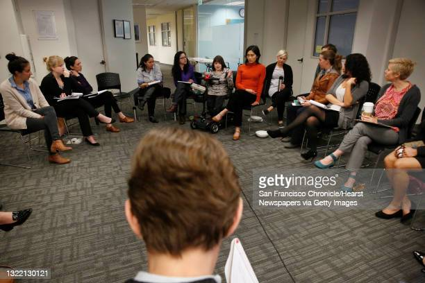 Elizabeth Kristen , Legal Aid At Work director gender equality and LGBT rights program; sits in a cirlce with others after small breakout session,...