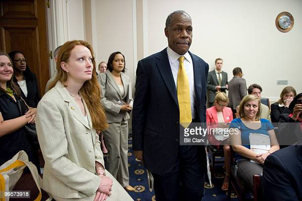 Elizabeth Kucinich wife of Rep Dennis Kucinich DOhio watches as actor Danny Glover arrives for the global food crisis briefing Why are the World's...