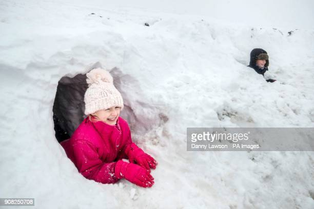 PARENTAL PERMISSION GRANTED Elizabeth Lewin and Matthew in a snow tunnel near Newby Head Farm in the Yorkshire Dales National Park