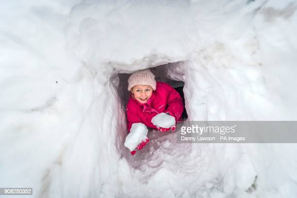 PARENTAL PERMISSION GRANTED Elizabeth Lewin in a snow tunnel near Newby Head Farm in the Yorkshire Dales National Park