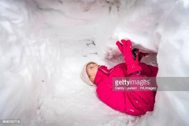PARENTAL PERMISSION GRANTED Elizabeth Lewin inside a snow tunnel near Newby Head Farm in the Yorkshire Dales National Park