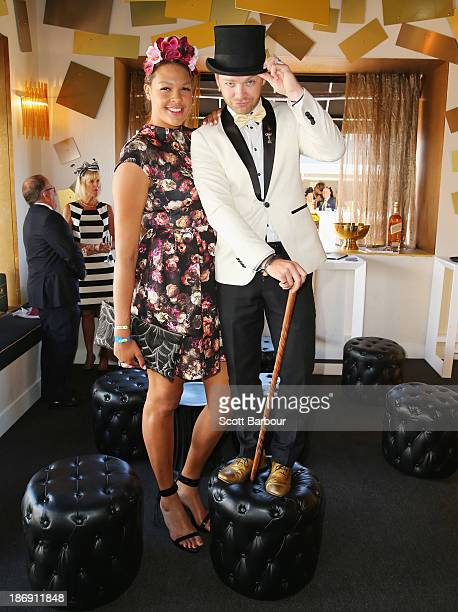 Elizabeth 'Liz' Cambage and Brodie Young attend the Johnnie Walker marquee during Melbourne Cup Day at Flemington Racecourse on November 5 2013 in...