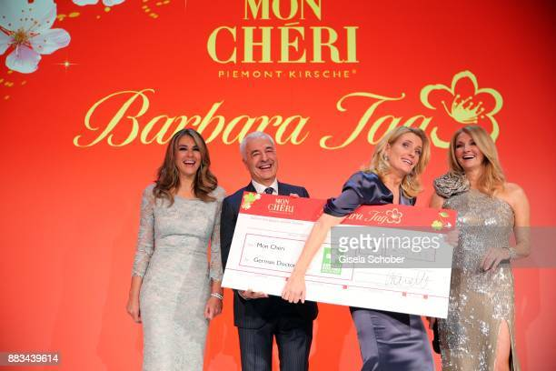 Elizabeth 'Liz' Hurley Carlo Vassallo Director Ferrero Germanyand Dr Maria Furtwaengler with check and Frauke Ludowig during the Mon Cheri Barbara...