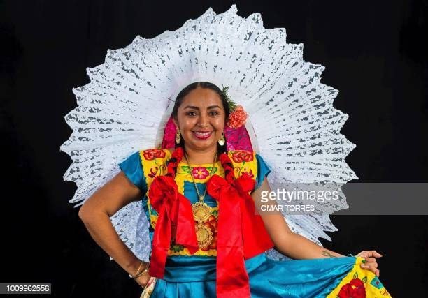 Elizabeth Lopez from Juchitan de Zaragoza poses during a rehearsal for the Guelaguetza traditional festival in Oaxaca Mexico on July 29 2018...