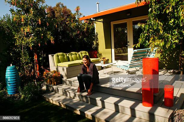 Elizabeth Low sits on the deck off the master bedroom at the home she and her husband David Low own and live in with their two year old daughter...