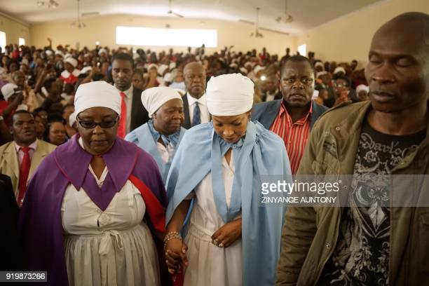 Elizabeth Macheka widow of the late opposition leader Morgan Tsvangirai is comforted as she enters Mabelreign Methodist Church for a memorial service...