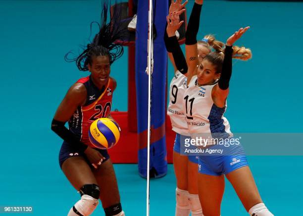 Elizabeth Martinez of Dominican Republic in action against Julieta Lazcano and Clarisa Sagardia of Argentina during the FIVB Volleyball Nations...