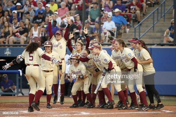 Elizabeth Mason of the Florida State Seminoles celebrates after a home run against the Washington Huskies during the Division I Women's Softball...